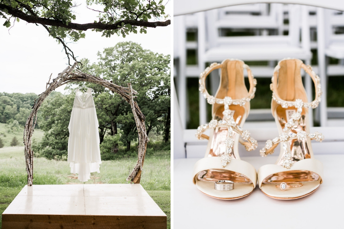 bridal_gown_hanging_from_outdoor_wooden_brance_arch_and_gold_jeweled_wedding_heels_sitting_with_rings.jpg