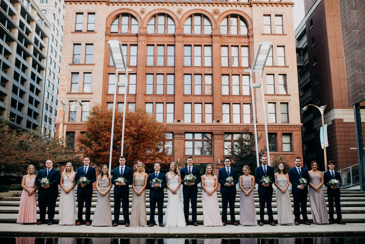 bridal_party_in_downtown_city_steps_rust_building_background.jpg