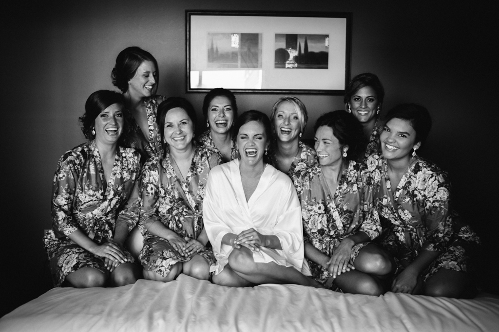 bridal_party_sitting_on_hotel_bed_floral_robes.jpg