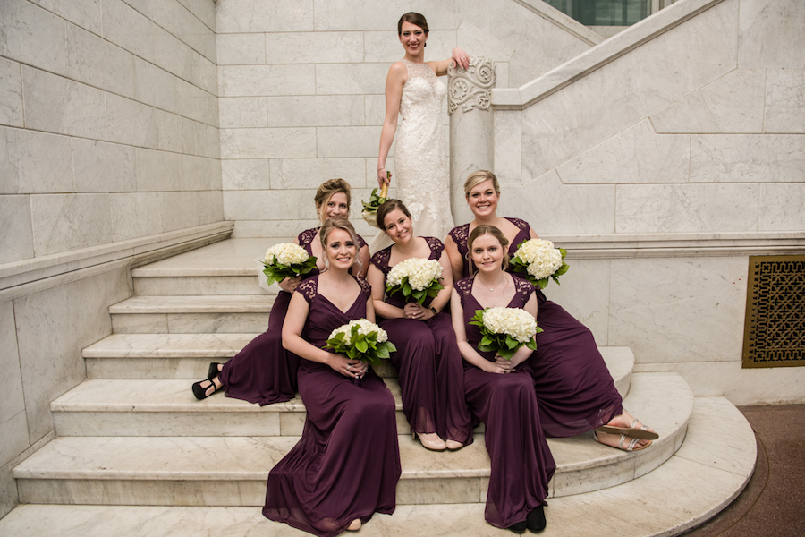 bridal_party_sitting_on_steps.jpg