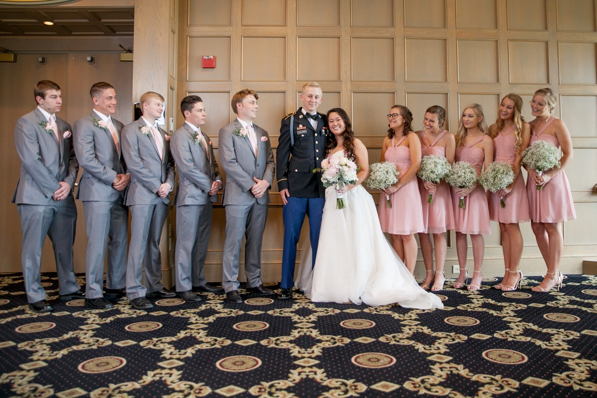 bridal_party_standing_indoors_wooden_square_wall.jpg