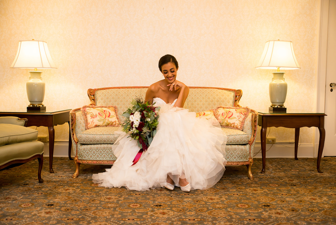 bride-holding-flowers-in-bridal_suite.jpg