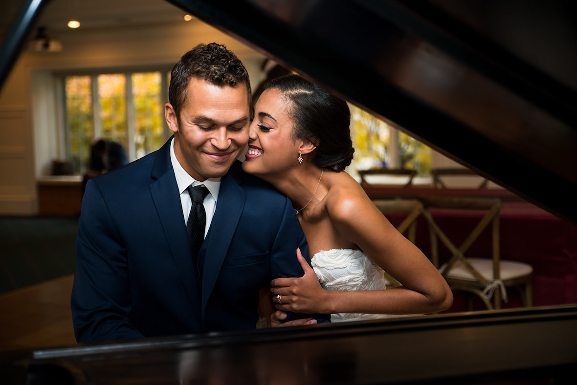 bride-kissing-groom-at-piano.jpg