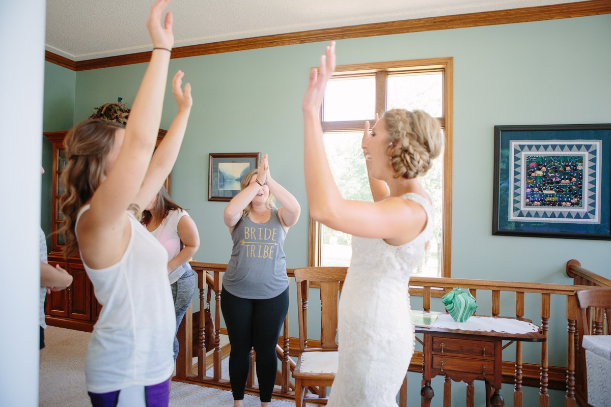 bride_and_bridesmaids_cheering_putting_arms_in_air.jpg