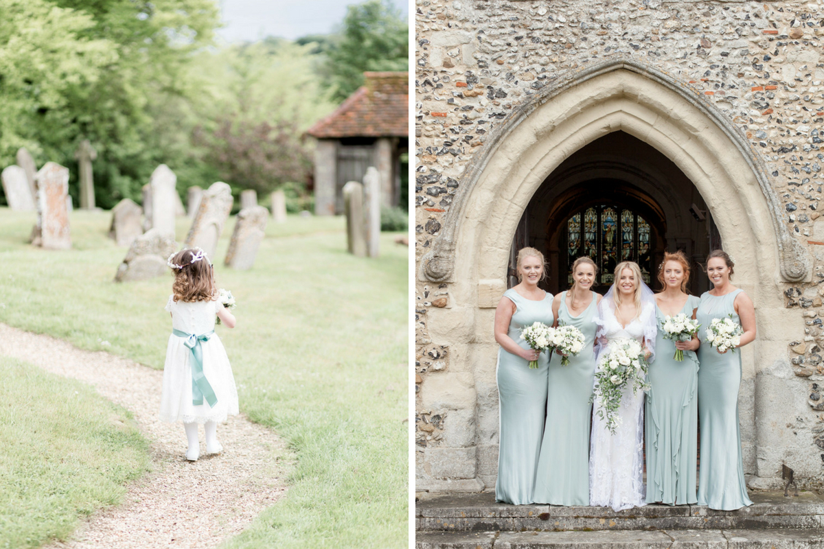 bride_and_bridesmaids_in_church_archway_teal_dresses_flower_girl_walking_down_path.jpg