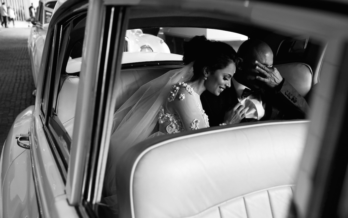 bride_and_dad_sharing_a_moment_in_a_car.jpg
