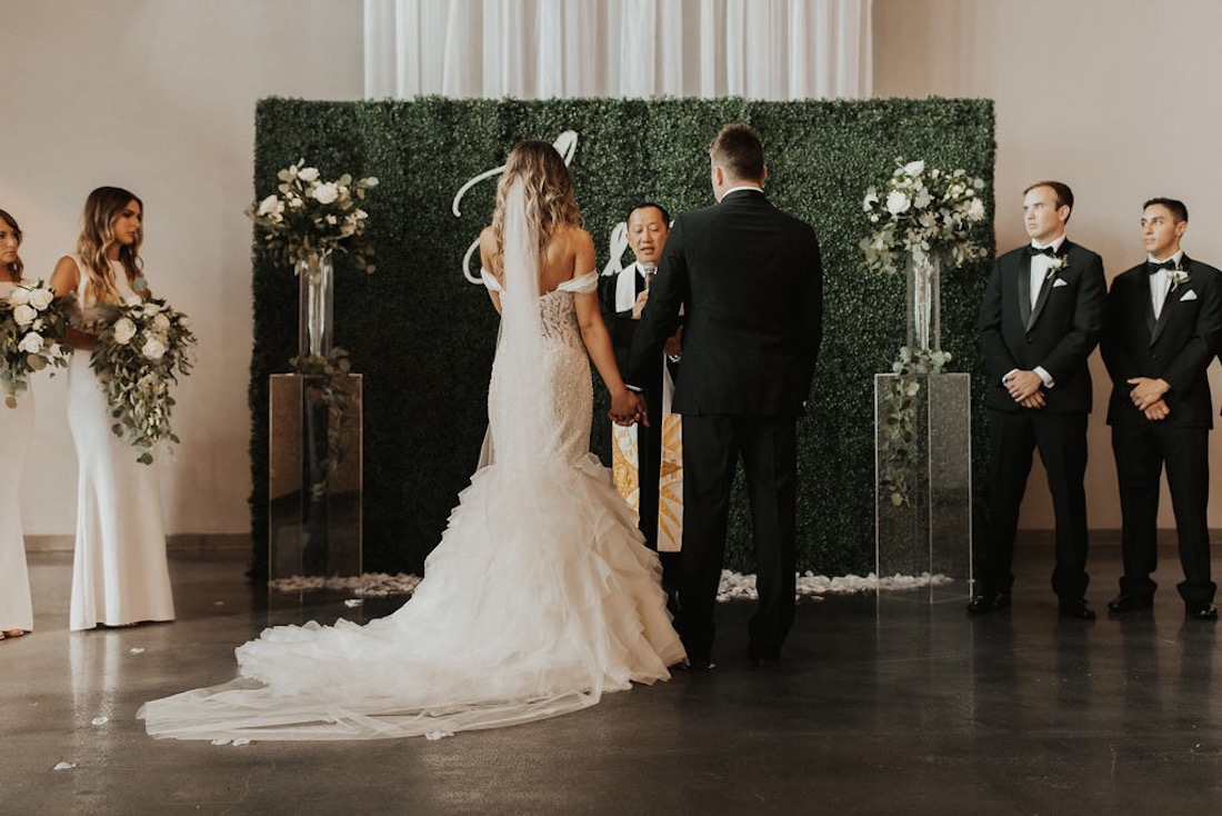 bride_and_groom_at_a_beautiful_alter.jpg