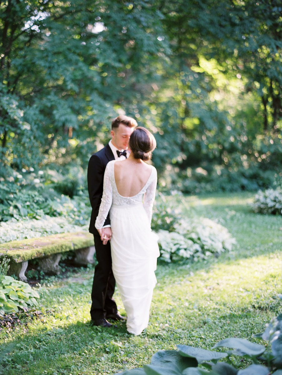 bride_and_groom_by_mossy_bench.jpg