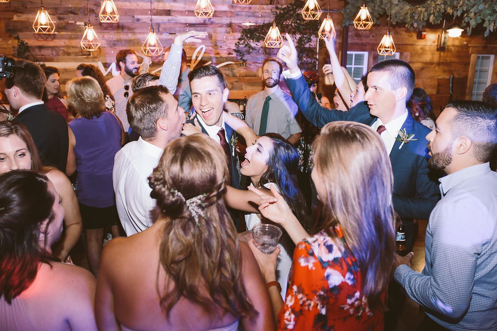 bride_and_groom_dance_with_guests.jpg