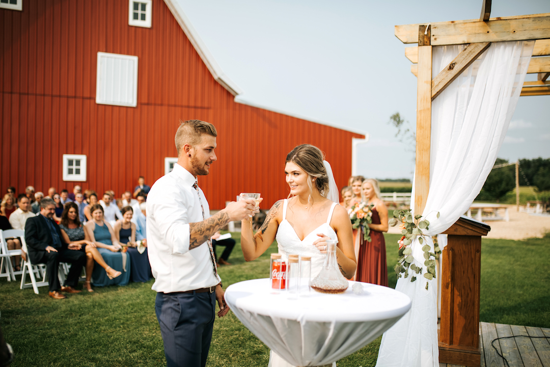 bride_and_groom_drink_during_ceremony.jpg