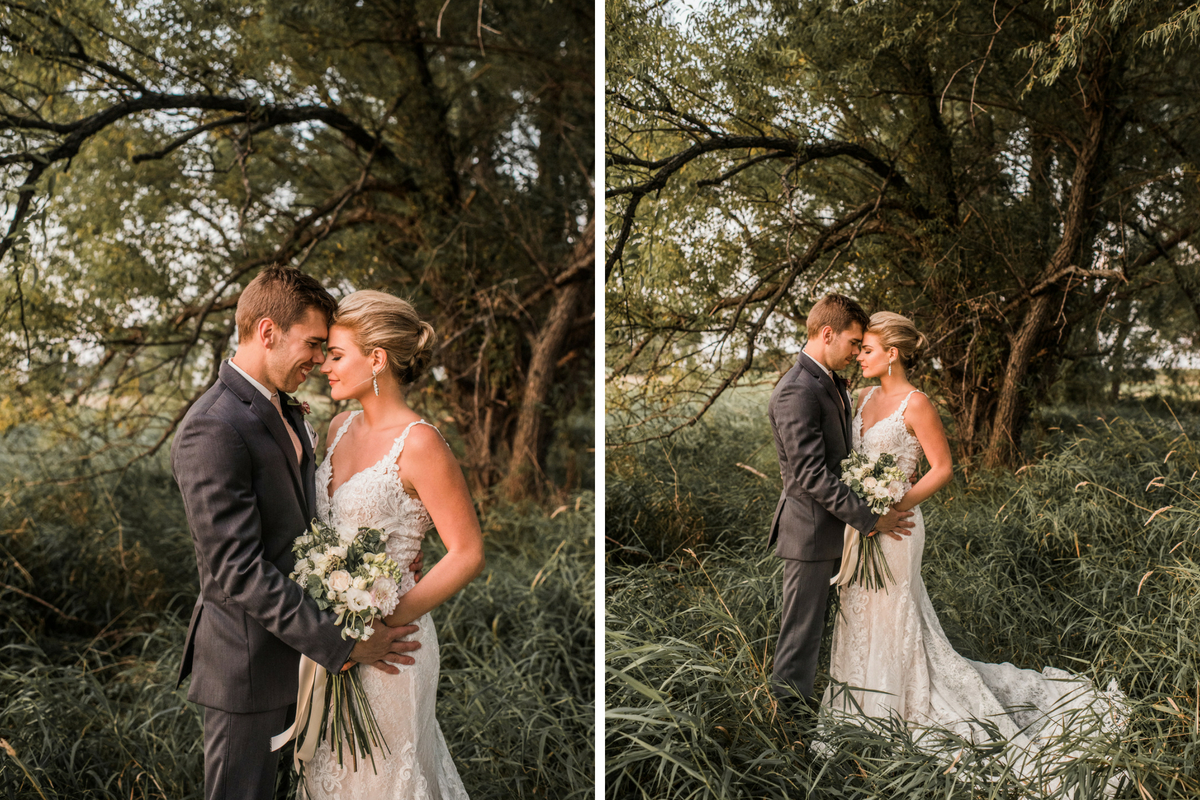 bride_and_groom_embrace_in_tall_grass_field_at_golden_hour.jpg