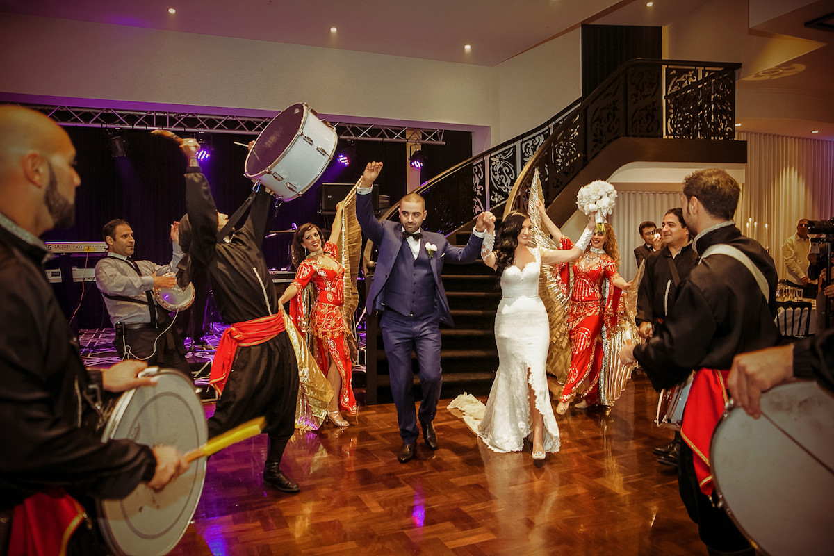 bride_and_groom_enterting_reception_dancing_and_laughing_band_playing.jpg