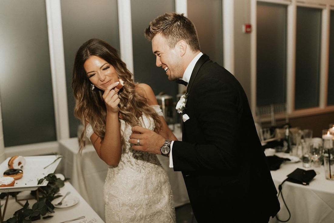 bride_and_groom_feeding_each_other_donuts.jpg