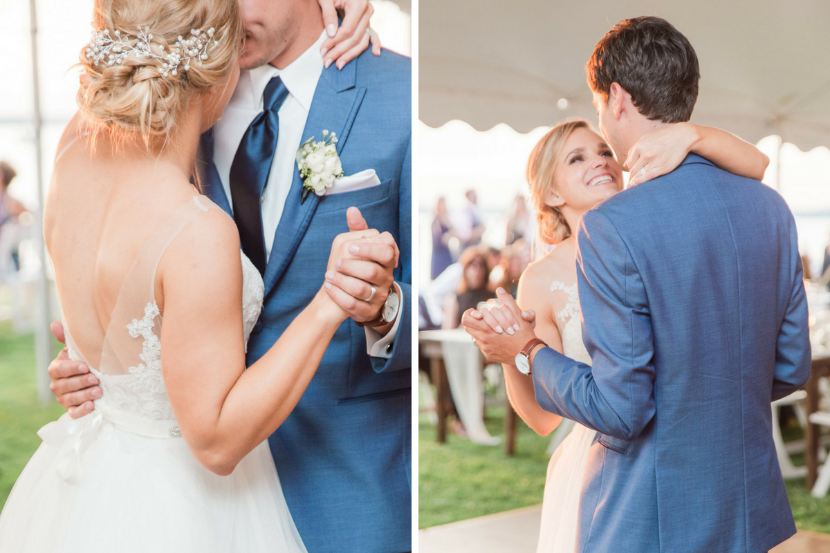 bride_and_groom_first_dance_as_sun_sets_under_white_tent_lakeside.jpg