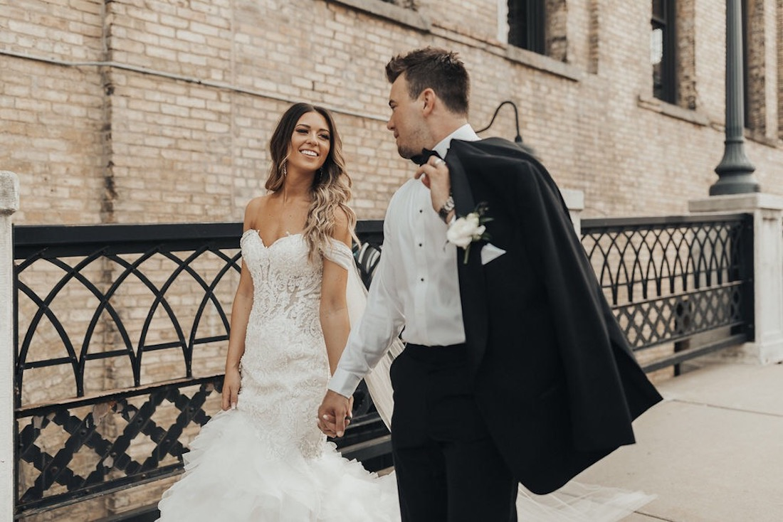 bride_and_groom_holding_hands_and_walking.jpg