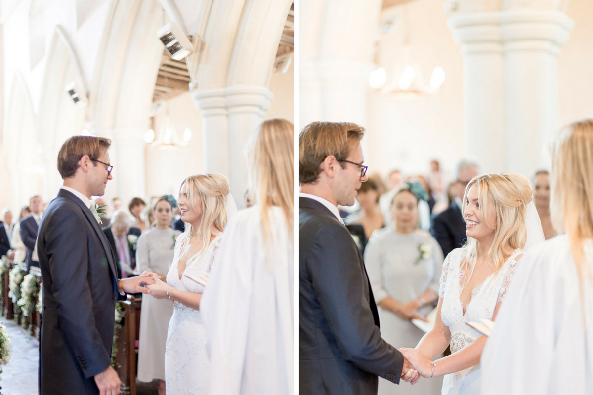 bride_and_groom_holding_hands_exchanging_vows_in_historic_uk_church.jpg