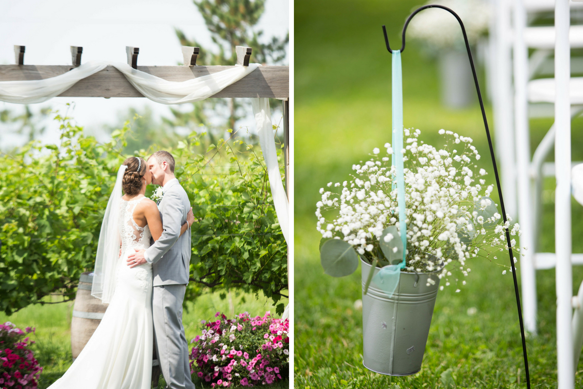 bride_and_groom_kiss_under_pretty_wooden_arch_flowers_hanging.jpg