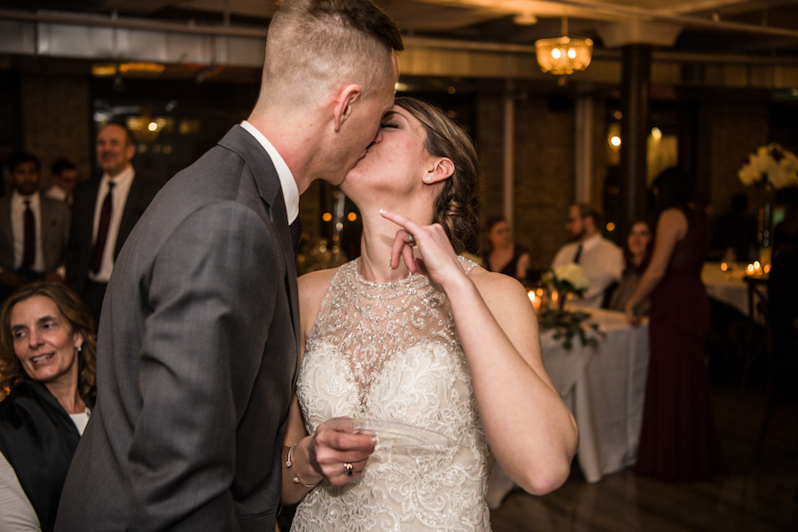 bride_and_groom_kissing_after_cake.jpg