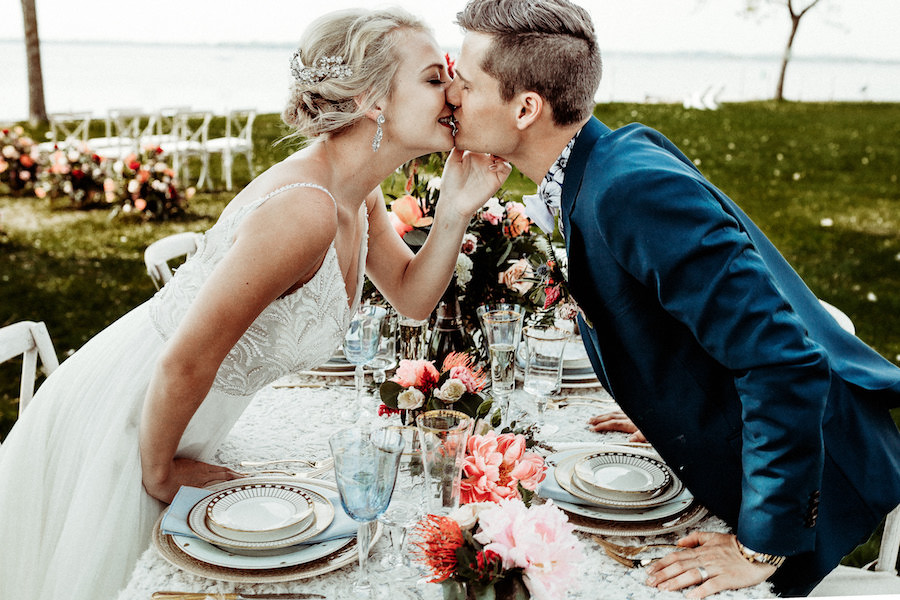 bride_and_groom_kissing_at_head_table.jpg
