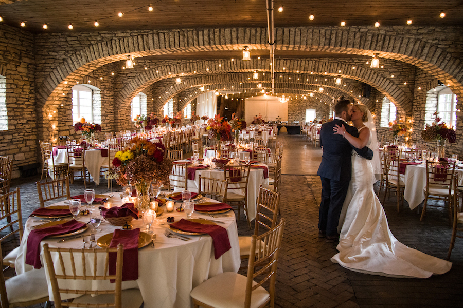 bride_and_groom_kissing_in_reception_hall.jpg