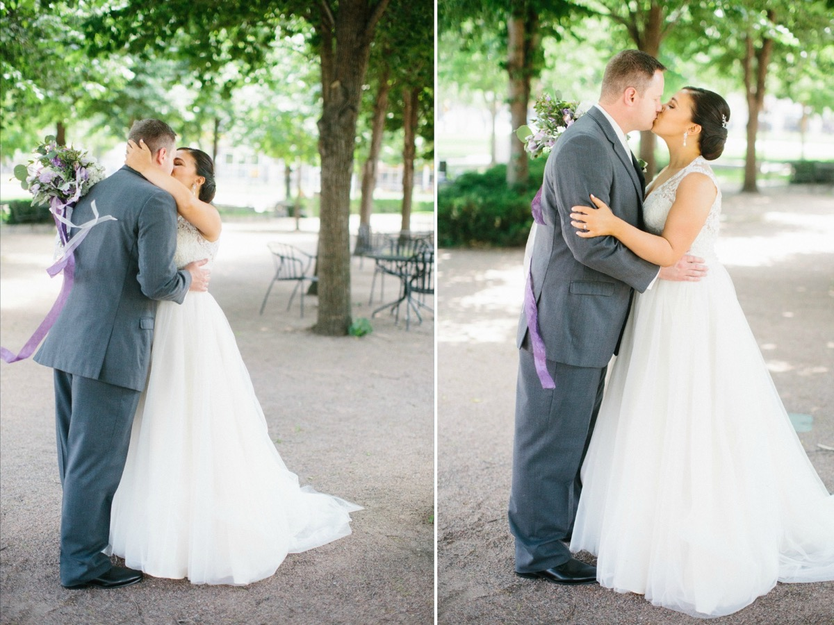 bride_and_groom_kissing_outdoors_sunny_day.jpg
