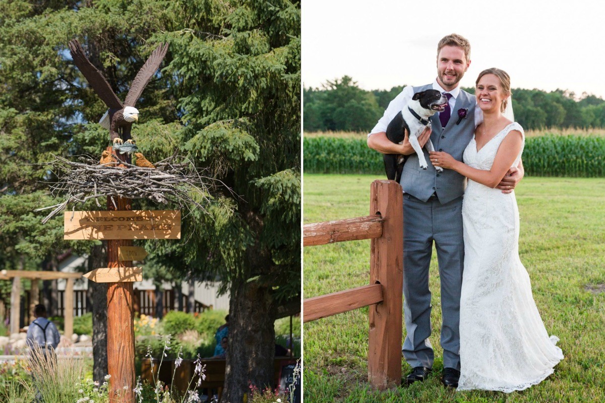 bride_and_groom_leaning_against_wooden_fence_holding_boston_terrier.jpg