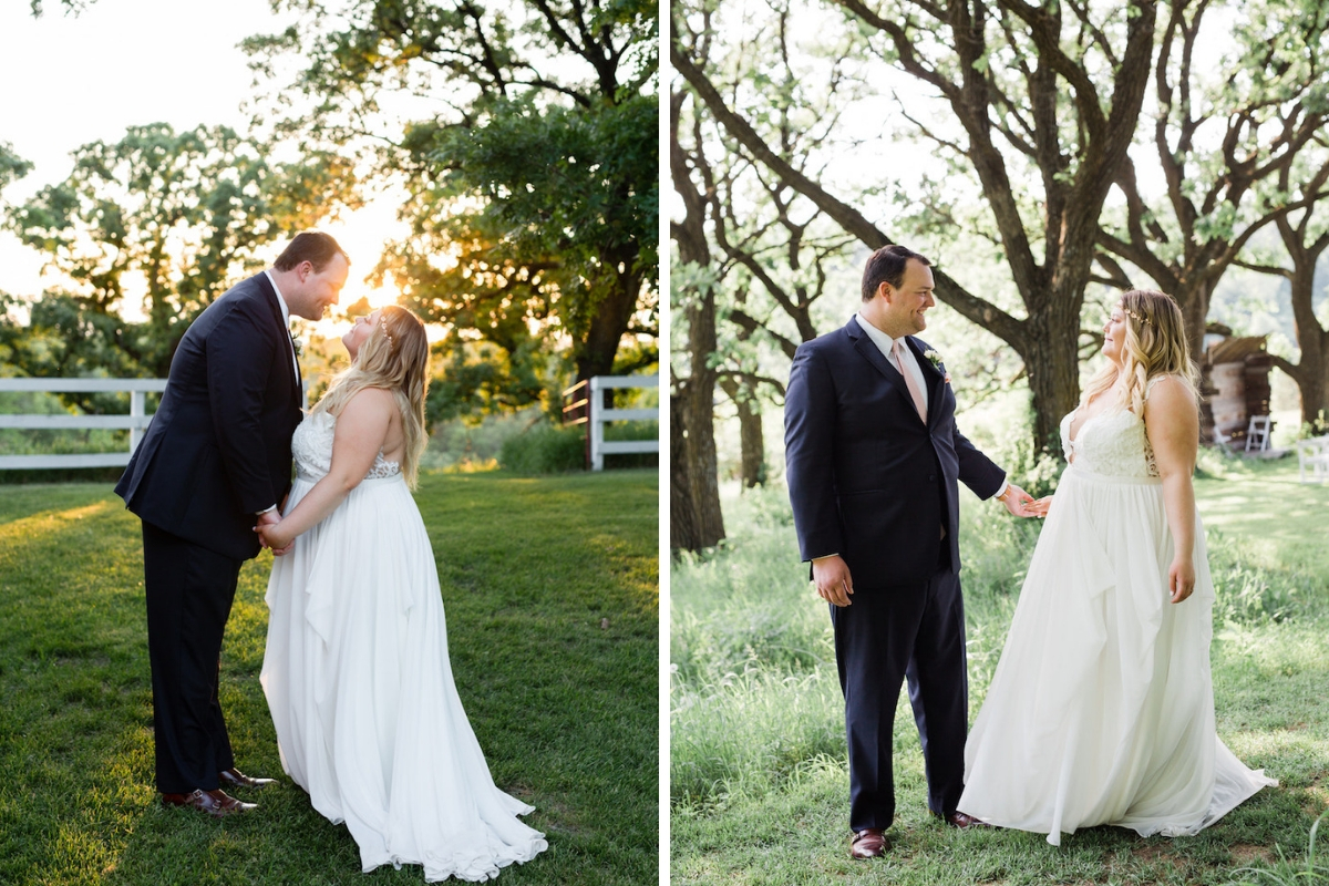 bride_and_groom_leaning_in_for_kiss_at_sunset_outdoor_venue_walking_in_grass_large_green_trees.jpg