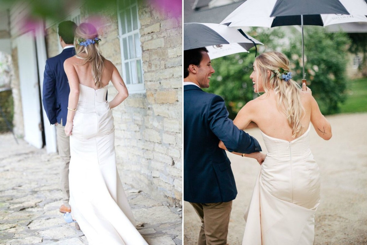 bride_and_groom_linking_arms_black_and_white_umbrella.jpg