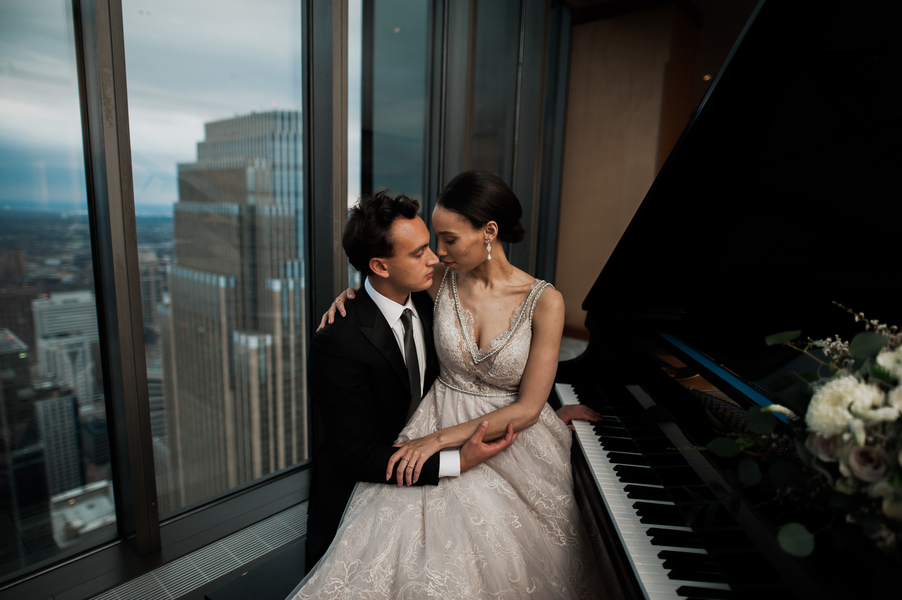 bride_and_groom_playing_piano_together_at_wedding_reception.jpg