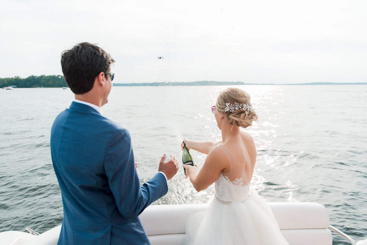 bride_and_groom_pop_champaigne_lake_minnetonka.jpg