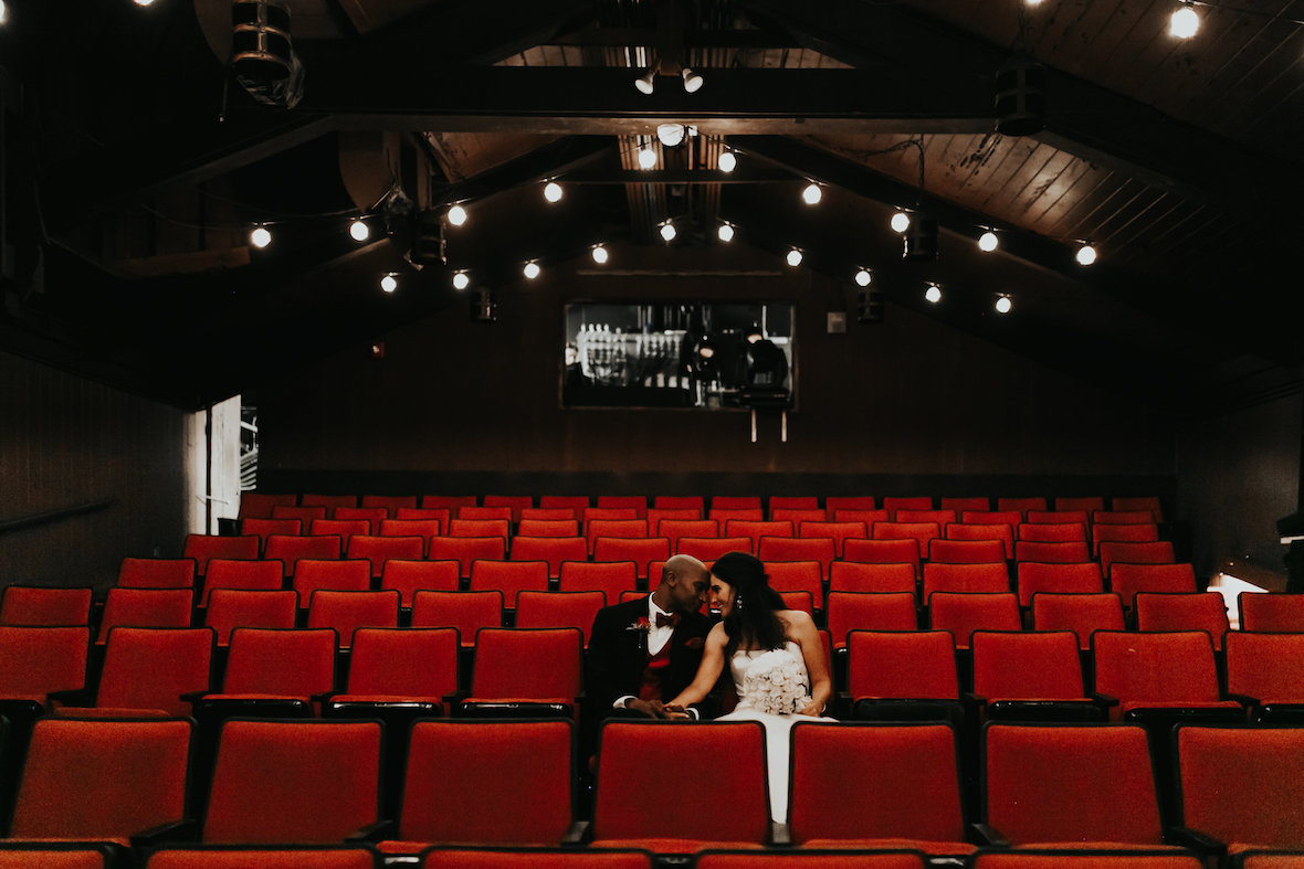 bride_and_groom_red_theatre_seats.jpg