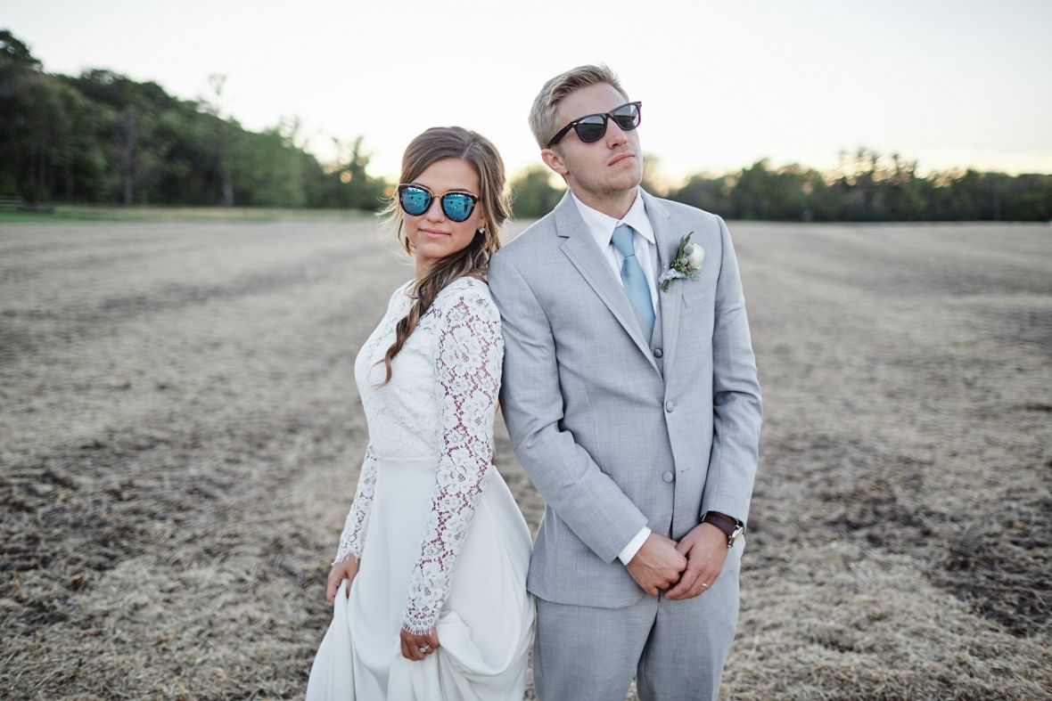 bride_and_groom_serious_faces_wearing_sunglasses.jpg