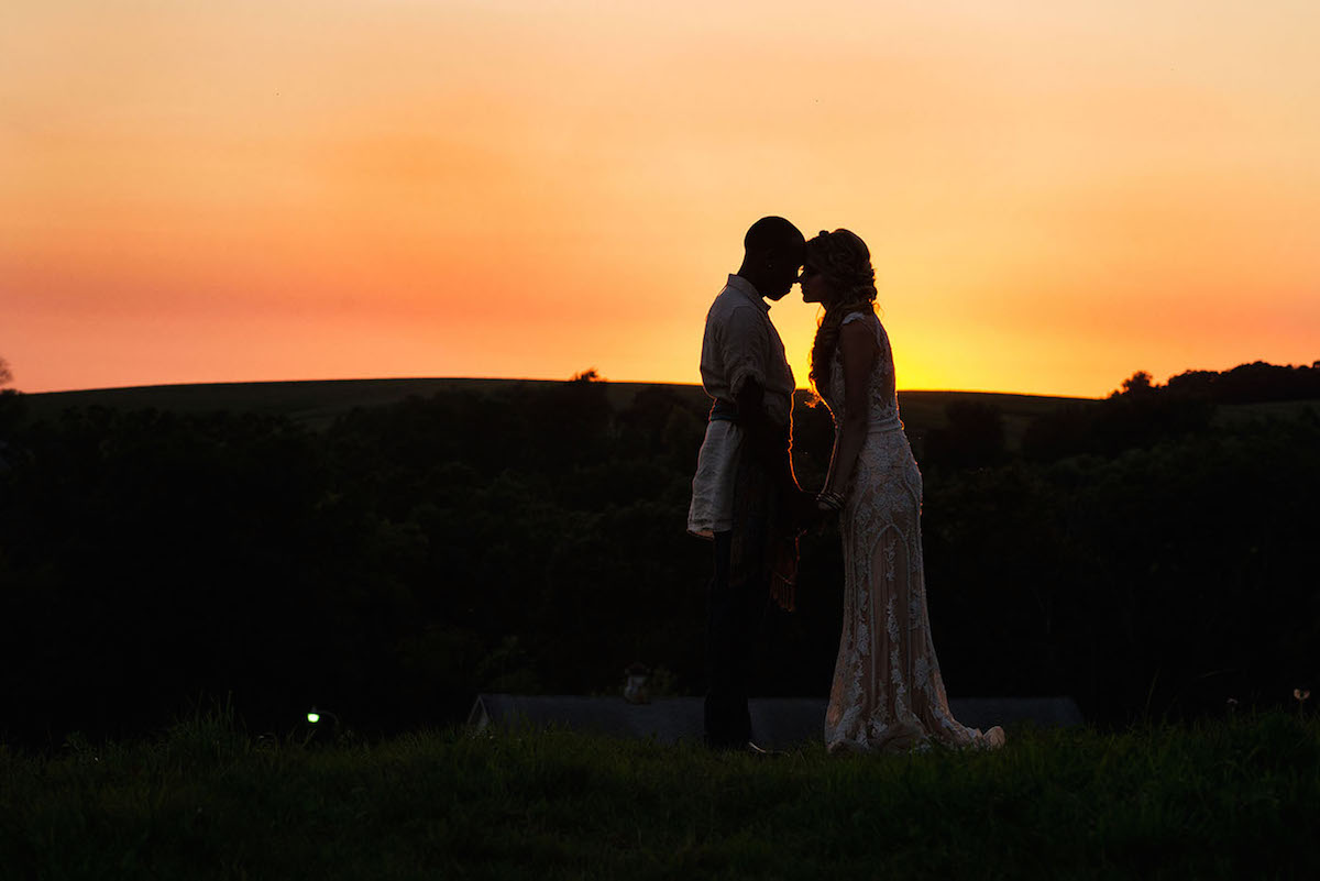 bride_and_groom_silhouettes_at_sunset.jpg