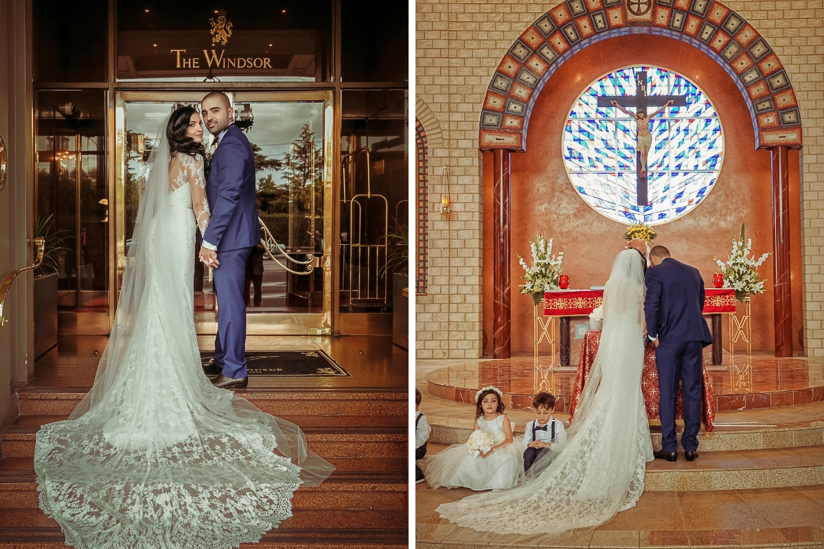 bride_and_groom_standing_together_holding_hands_in_church_bridal_gown_train_spread_out_across_floor.jpg