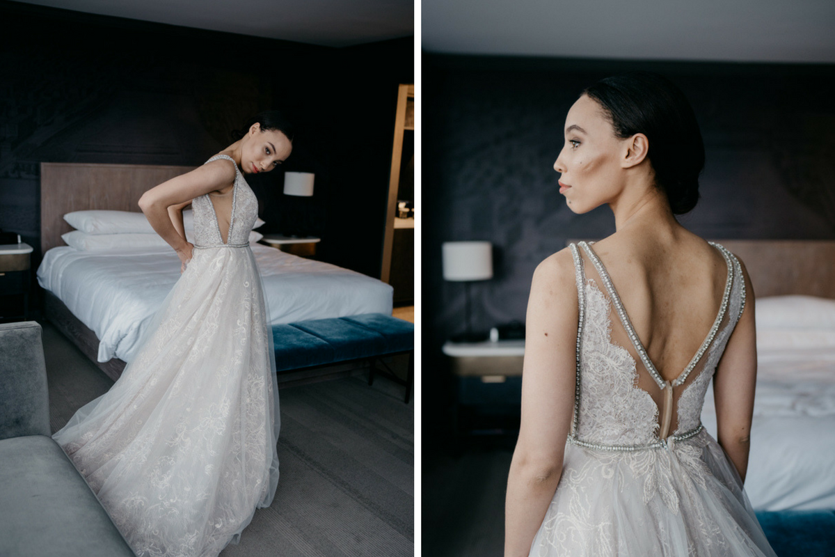 bride_buttoning_her_own_wedding_dress_in_minneapolis_hotel.png