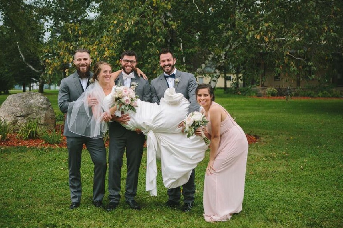 bride_carried_by_bridal_party.jpg