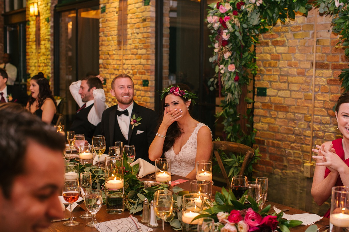 bride_covering_mouth_with_hand_wedding_reception_speeches.jpg