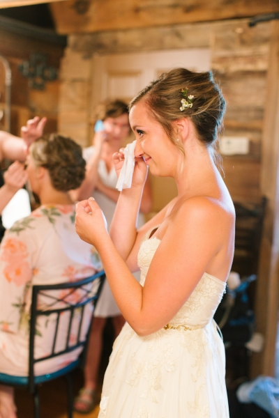 bride_crying_wiping_eyes_with_tissue_in_a_strapless_gown.jpg