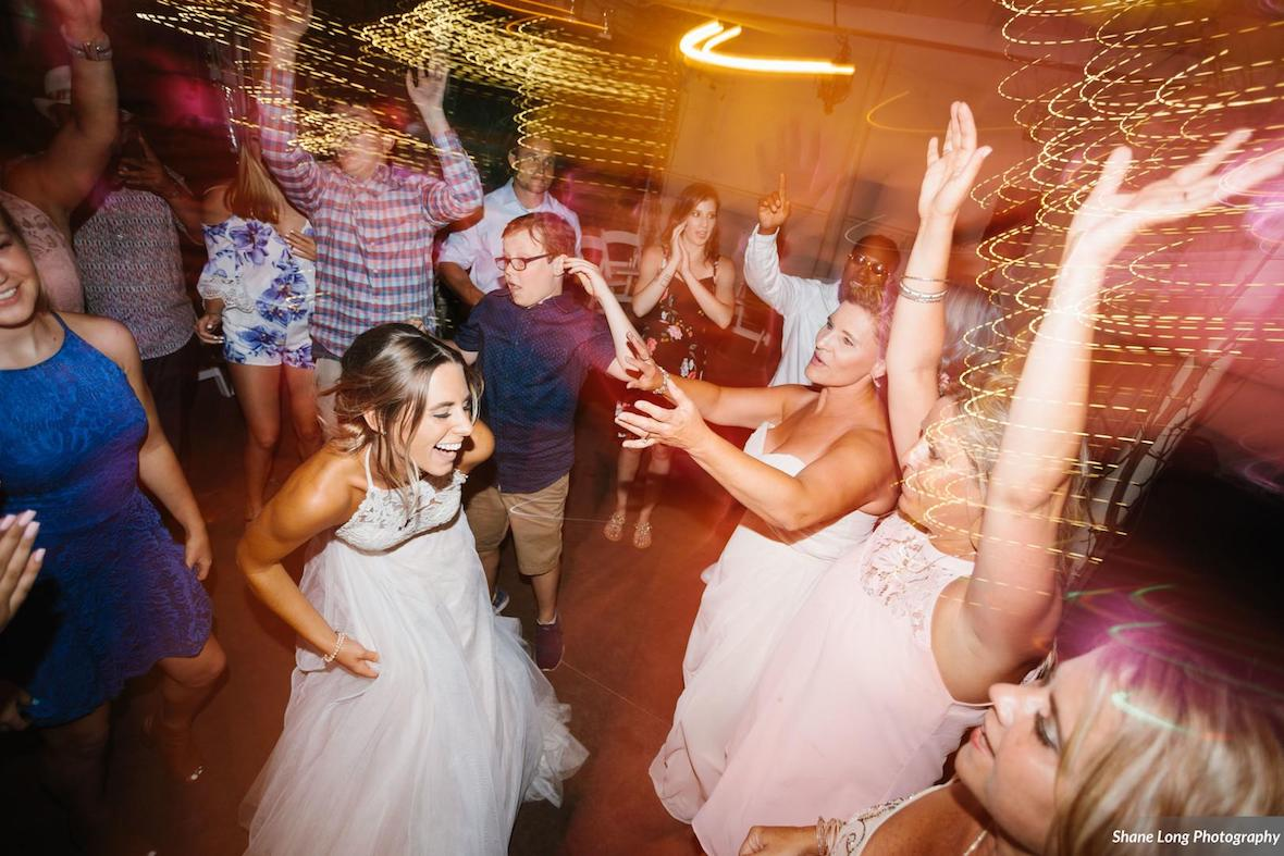 bride_dancing_with_friends.jpg