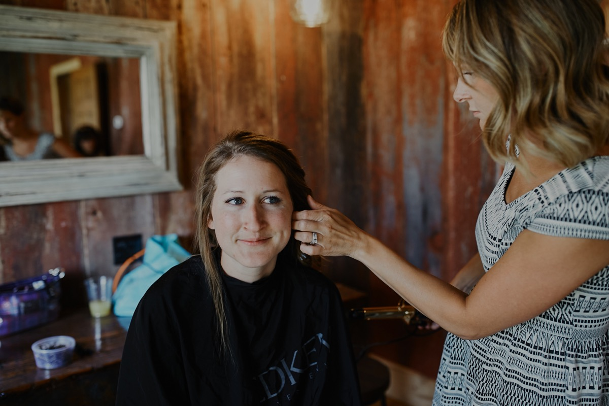 bride_getting_her_hair_curled_in_barn_room.JPG