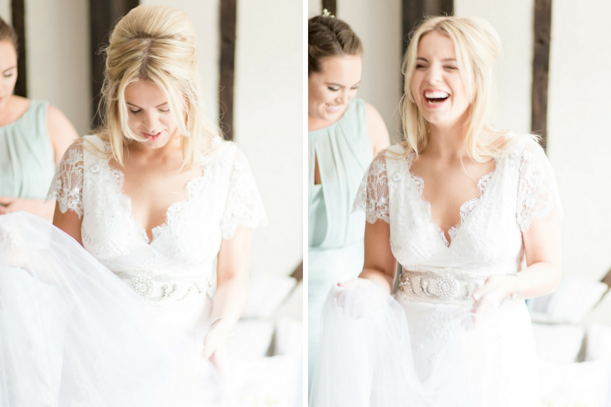 bride_getting_ready_in_gown_laughing_with_bridesmaids.jpg