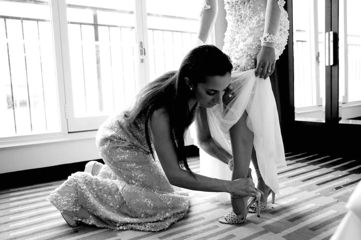 bride_getting_shoes_on.jpg