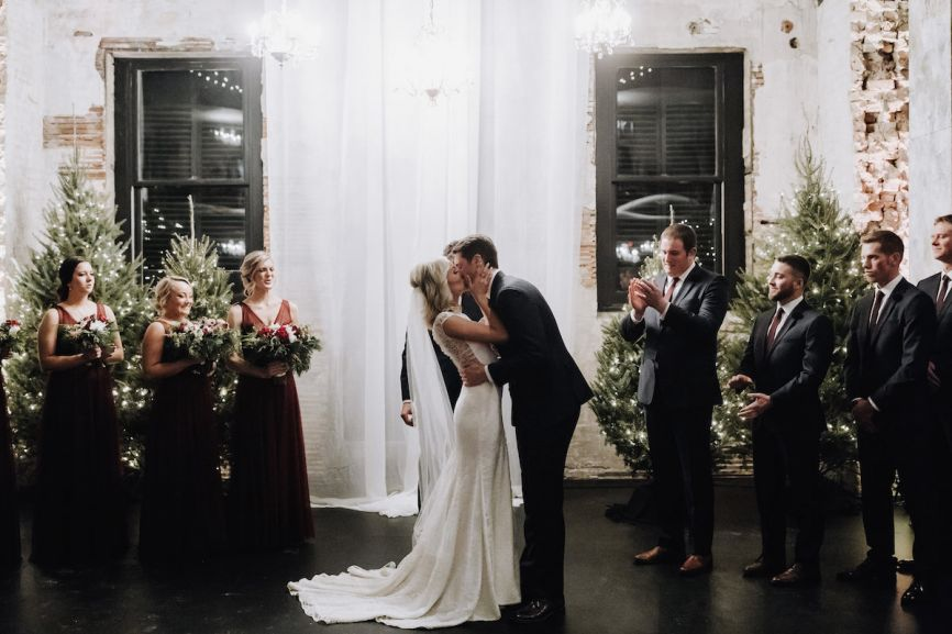 bride_groom_kissing_minneapolis_winter_warehouse_wedding.jpg