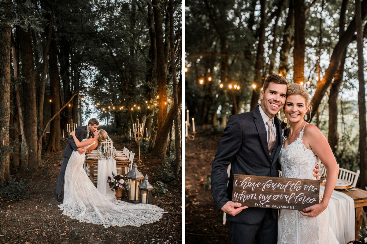 bride_groom_kissing_under_twinkling_string_lights_wooded_wedding_setting.jpg