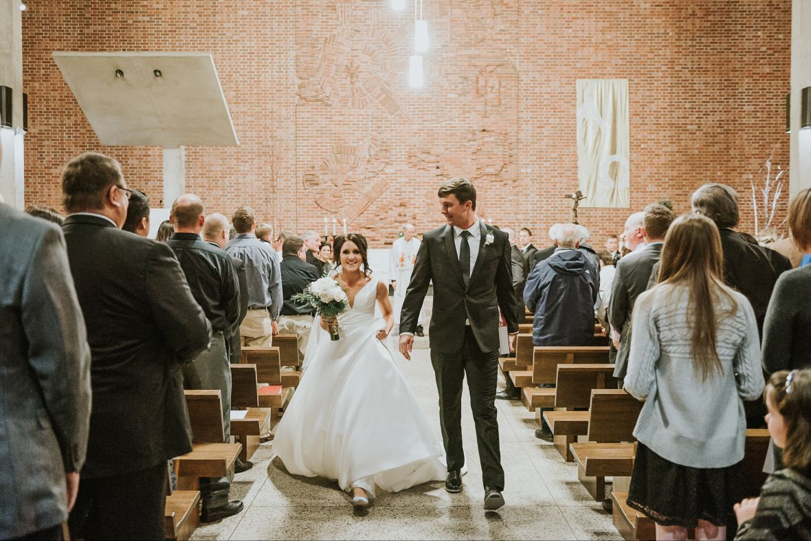 bride_groom_leaving_ceremony_brick_church.jpg