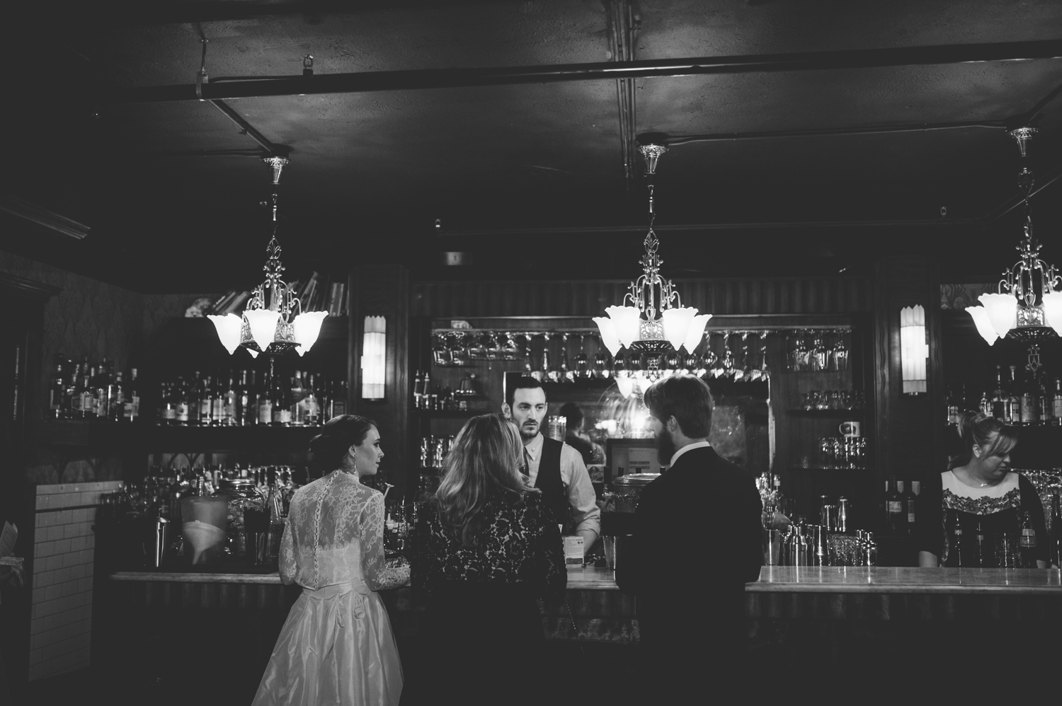 bride_groom_ordering_drinks_at_vintage_bar.jpeg
