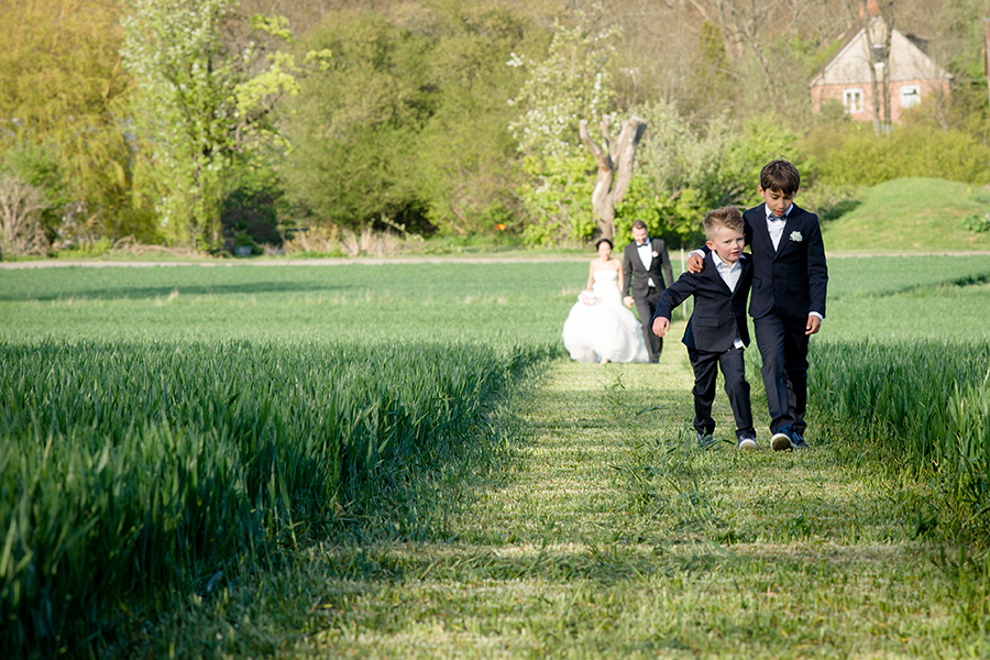 bride_groom_sons_ringbearers_green_field.jpg
