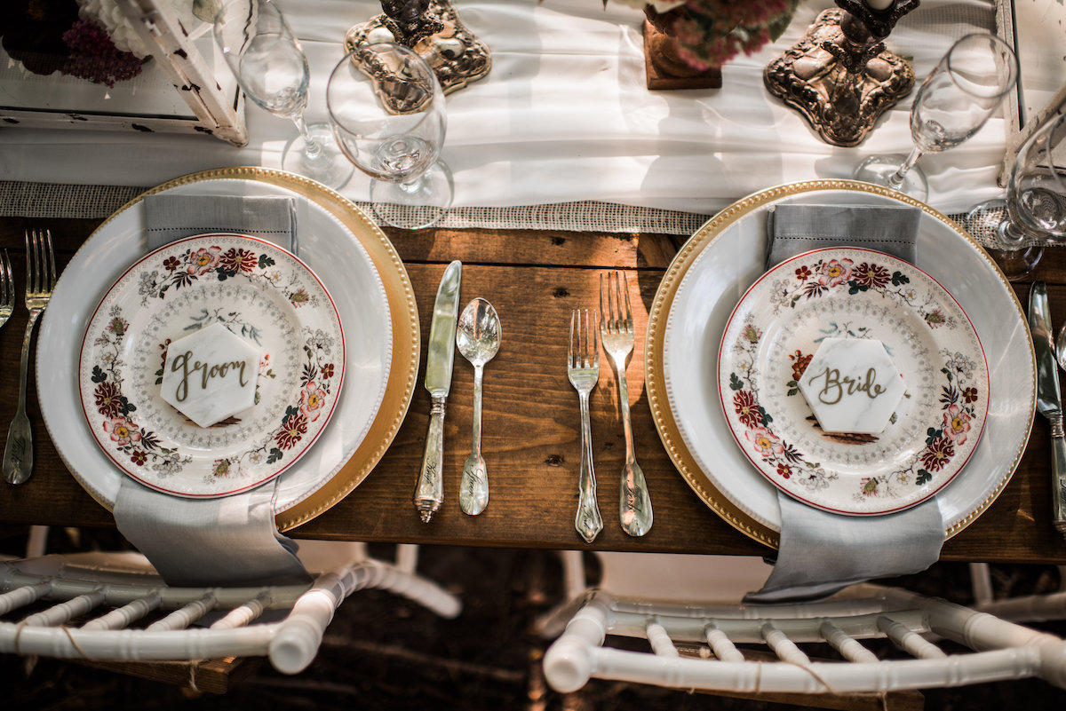 bride_groom_table_setting_wooden_table_forest.jpg