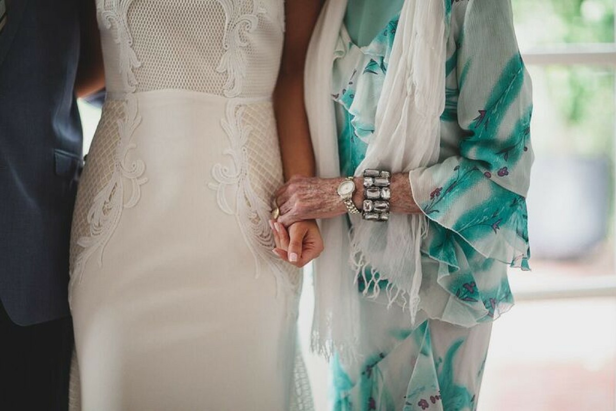 bride_holding_hands_with_grandparents.jpg