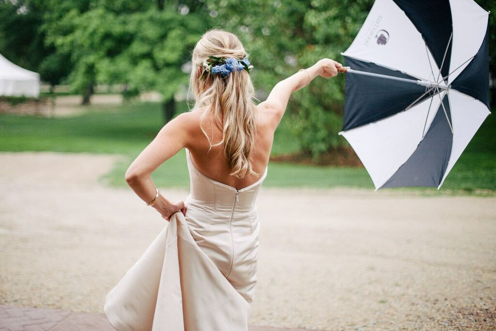 bride_holding_out_black_and_white_striped_umbrella.jpeg